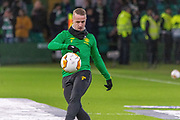Leigh Griffiths of Celtic FC warms up ahead of the Europa League match between Celtic and FC Copenhagen at Celtic Park, Glasgow, Scotland on 27 February 2020.