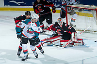 KELOWNA, CANADA - MARCH 14:  Taylor Gauthier #35 of the Prince George Cougars misses a first period save on a back handed shot by Nolan Foote #29 of the Kelowna Rockets after returning to the ice after missing 17 games on March 14, 2018 at Prospera Place in Kelowna, British Columbia, Canada.  (Photo by Marissa Baecker/Shoot the Breeze)  *** Local Caption ***