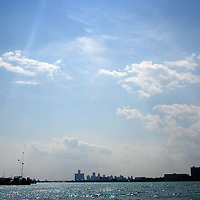 The Detroit city skyline is seen in the distance on the Detroit River in Detroit, Michigan on August 7, 2010. Melanie Maxwell