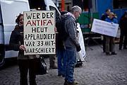 Frankfurt am Main | 30 Mar 2015<br /> <br /> Am Montag (30.03.2015) demonstrierten etwa 40 Menschen unter dem Namen &quot;Freie B&uuml;rger f&uuml;r Deutschland&quot; auf dem R&ouml;merberg in Frankfurt am Main gegen Islamisierung und zahlreiche andere &Uuml;bel, die Gruppe war zuvor unter dem Namen &quot;PEGIDA&quot; aufgetreten. Etwa 600 Menschen protestierten lautstark gegen diese Kundgebung.<br /> Hier: &quot;Freie B&uuml;rger f&uuml;r Deutschland&quot;-Demonstrant mit einem Plakat mit der Aufschrift &quot;Wer der Antifa heute applaudiert w&auml;r 33 mitmarschiert&quot;.<br /> <br /> &copy;peter-juelich.com<br /> <br /> [No Model Release | No Property Release]