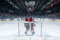 KELOWNA, CANADA - MARCH 27: Eric Comrie #1 of Tri-City Americans stands in net during the national anthem of the first game of round 1 playoffs against the Kelowna Rockets on March 27, 2015 at Prospera Place in Kelowna, British Columbia, Canada.  (Photo by Marissa Baecker/Getty Images)  *** Local Caption *** Eric Comrie;