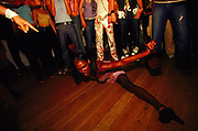 A woman doing the splits on the dance floor at Drama upstairs at Browns 2000's