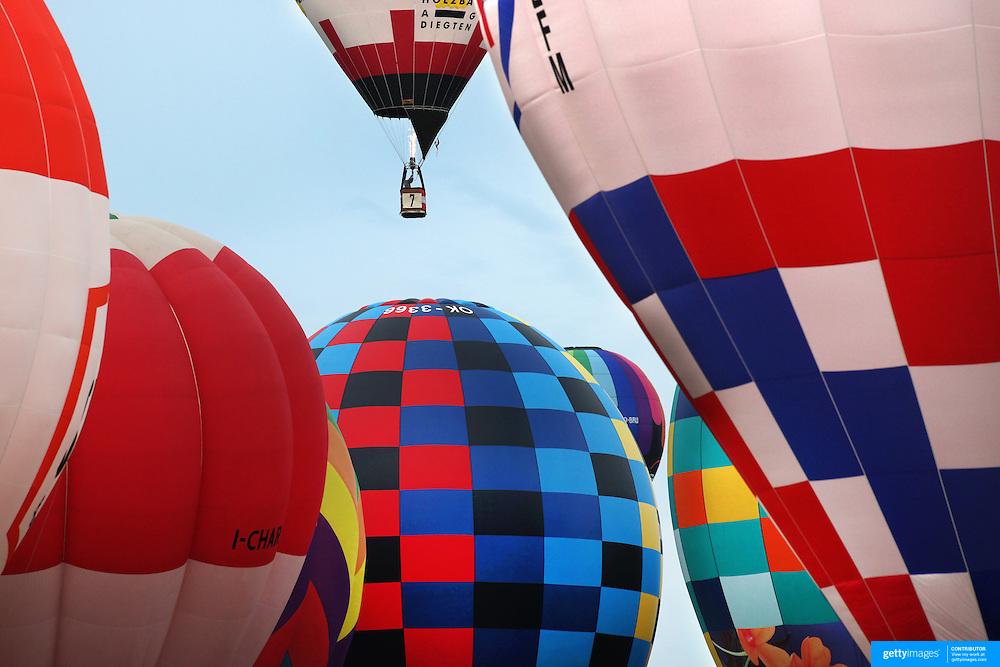 Werner Schrank, Austria, (top), takes to the skies around rural Michigan near Battle Creek as balloons launch during the World Hot Air Ballooning Championships. Battle Creek, Michigan, USA. 19th August 2012. Photo Tim Clayton
