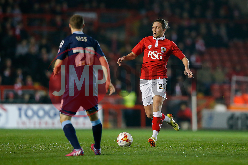 Luke Ayling of Bristol City is challenged by Jamie Ness of Crewe Alexandra - Photo mandatory by-line: Rogan Thomson/JMP - 07966 386802 - 17/03/2015 - SPORT - FOOTBALL - Bristol, England - Ashton Gate Stadium - Bristol City v Crewe Alexandra - Sky Bet League 1.