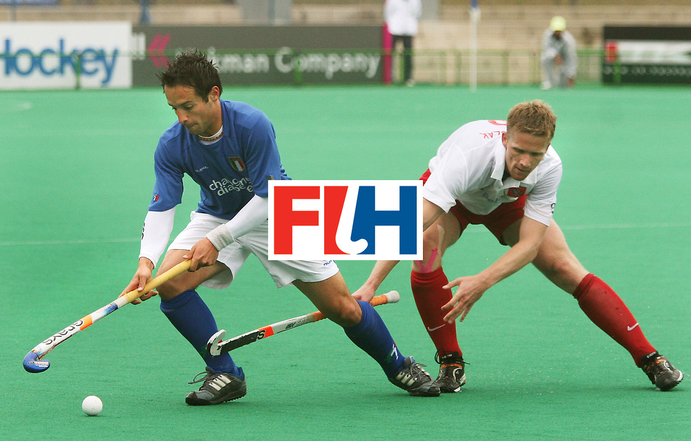 Kakamigahara (Japan): Zbigniew Juszczak of Italy gets past Miraslaw Kluczynski of Polandin the Olympic Hockey Qualifier at Gifu Perfectural Green Stadium at Kakamigahara on 10 April 2008. Poland beat Italy 6-0.<br /> Photo: GNN/ Vino John
