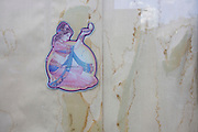 Detail of a girl dancer and stains from a damp window outside a closed Indian restaurant and take-away.