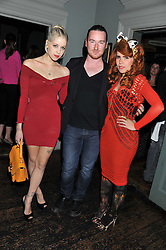 Left to right, PEACHES GELDOF, MARK FAST and PALOMA FAITH at 'Summer Goes By FAST,' a party celebrating London-based Canadian knitwear designer Mark Fast, held at Paradise, 19 Kilburn Lane, Kensal Green, London on 28th July 2011.