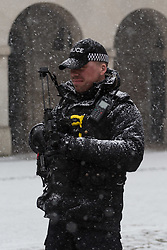 An armed police officer braves the snow as a sudden flurry hits Westminster at Horseguards. Westminster, London, February 27 2018.