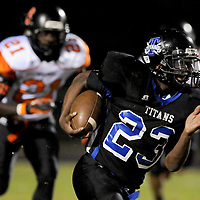 Trask High School's Steven Jordan rushes past Wallace-Rose Hill High School's De'andre Dawson Friday September 26, 2014 in Rocky Point, N.C. (Jason A. Frizzelle)