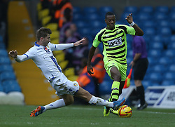 Yeovil Town's Liam Davis is tackled by Leeds United's Luke Murphy-Photo mandatory by-line: Matt Bunn/JMP - Tel: Mobile: 07966 386802 02/11/2013 - SPORT - FOOTBALL - Elland Road - Leeds - Leeds United v Yeovil Town - Sky Bet Championship