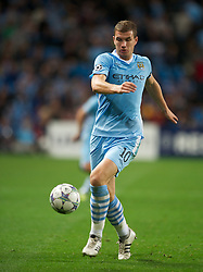 MANCHESTER, ENGLAND - Wednesday, September 14, 2011: Manchester City's Edin Dzeko in action against SSC Napoli during the UEFA Champions League Group A match at the City of Manchester Stadium. (Photo by Chris Brunskill/Propaganda)