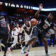 Kassoum Yakwe, St. John's, is fouled by 	Eric Cobb, South Carolina, during the St. John's vs South Carolina Men's College Basketball game in the Hall of Fame Shootout Tournament at Mohegan Sun Arena, Uncasville, Connecticut, USA. 22nd December 2015. Photo Tim Clayton