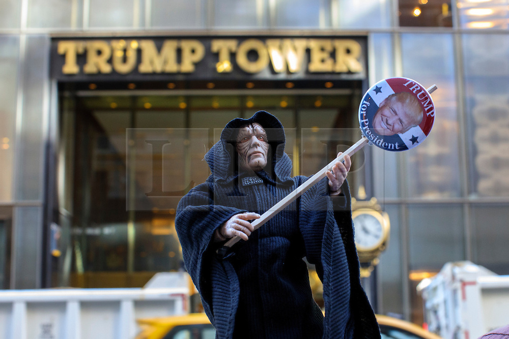© Licensed to London News Pictures. 08/11/2016. New York CIty, USA. A pro-Hillary Clinton and Democrat supporter poses with a Star Wars figure outside Trump Tower in New York City on Tuesday, 8 November, the day of the presidential election in the United States of America. Photo credit: Tolga Akmen/LNP