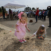 lila Luster, 3, left, and Mary Phillips Mathis, 4, play in the dirt as the groundbreaking ceremony for the new Specialty Orthopedic Group building is goin on nearby Friday on South Sgloster in Tupelo.