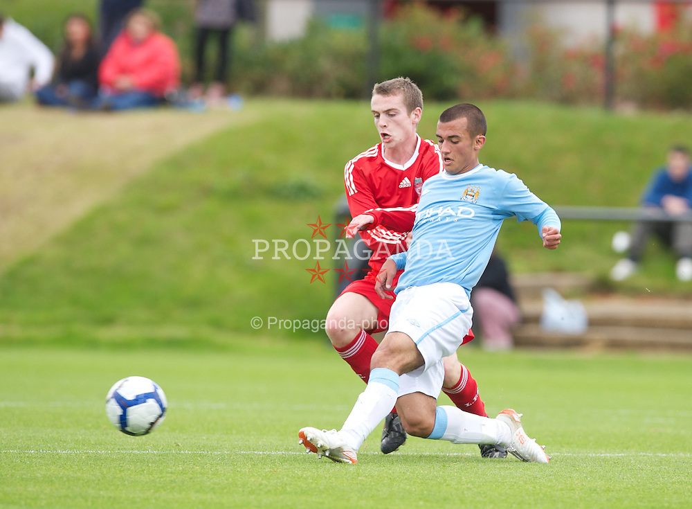 LIVERPOOL, ENGLAND - Saturday, September 26, 2009: Liverpool's Michael Roberts in action against Manchester City's Ahmed Benali during the FA Premier Academy League match at the Kirkby Academy. (Pic by David Rawcliffe/Propaganda) 8 6