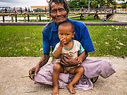 12 JUNE 2013 - YANGON, MYANMAR:  A man and his son in a park in Yangon, Myanmar.        PHOTO BY JACK KURTZ