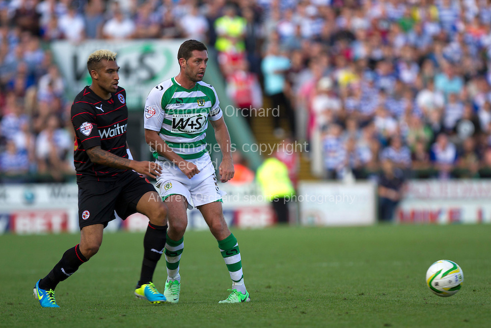 Jamie McAllister of Yeovil Town &reg; and Danny Williams of Reading during the Skybet championship match, Yeovil Town v Reading at Huish Park in Yeovil on Saturday 31st August 2013. <br /> Picture by Sophie Elbourn, Andrew Orchard sports photography,
