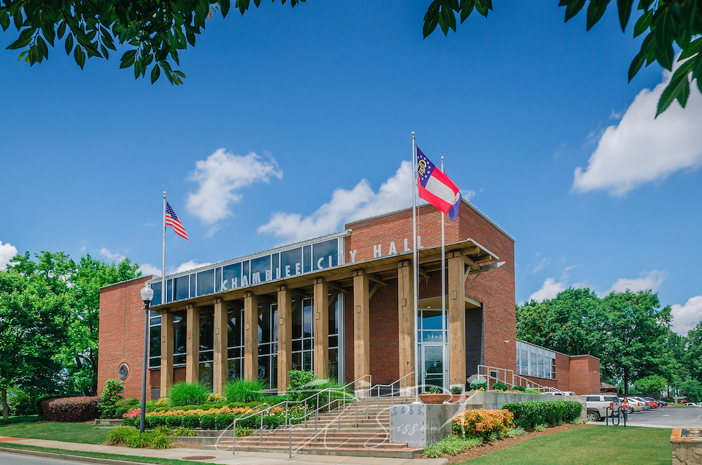 "Flags fly outside Chamblee City Hall in Chamblee, Georgia, June 10, 2014. Chamblee was incorporated in 1907 and had a population of 9,892 people according to the 2010 U.S. Census. The city's motto is, ""A City on the Right Track."" (Photo by Carmen K. Sisson/Cloudybright)"