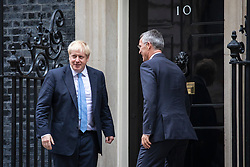 © Licensed to London News Pictures. 15/10/2019. London, UK. Prime Minister Boris Johnson (L) shakes hands with Secretary General of NATO Jens Stoltenberg (R) outside 10 Downing Street. Photo credit: Rob Pinney/LNP