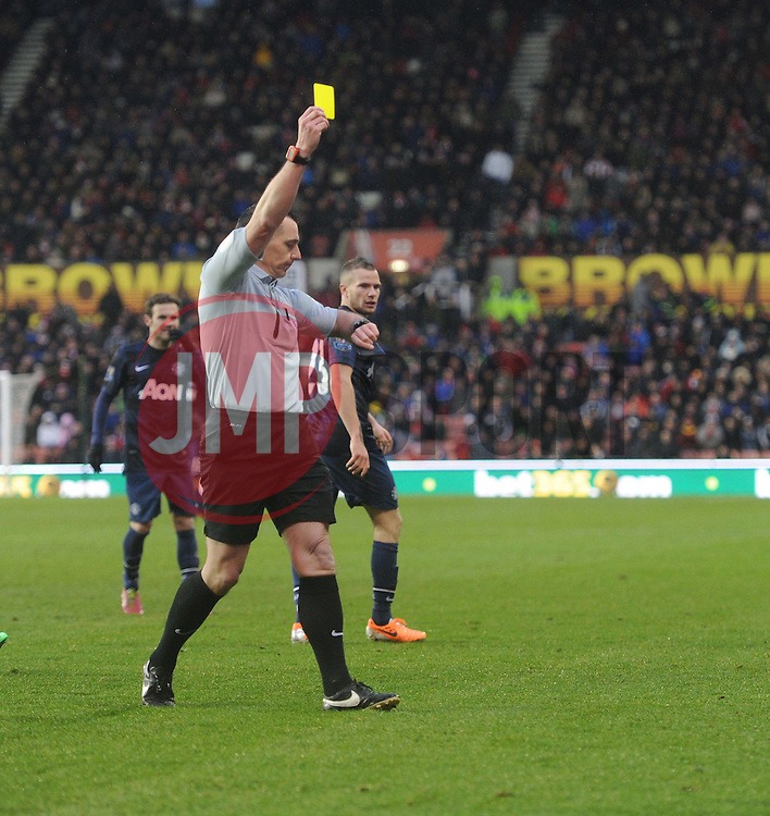 Stoke City's Geoff Cameron booked for time wasting as the ref looks at his watch. - Photo mandatory by-line: Alex James/JMP - Tel: Mobile: 07966 386802 01/02/2014 - SPORT - FOOTBALL - Britannia Stadium - Stoke-On-Trent - Stoke v Manchester United - Barclays Premier League