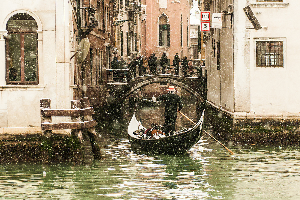 VENICE, ITALY - 28th FEBRUARY/01st MARCH 2018<br /> A gondoler sails a small canal during a snowfall in Venice, Italy. A blast of freezing weather called the &ldquo;Beast from the East&rdquo; has gripped most of Europe in the middle of winter of 2018, and in Venice A snowfall has covered the city with white, making it fascinating and poetic for citizen and tourists.   &copy; Simone Padovani / Awakening