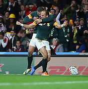 South Africa's Fourie du Preez (Captain) celebrating scoring a try with South Africa's Bryan Habana during the Rugby World Cup Quarter Final match between South Africa and Wales at Twickenham, Richmond, United Kingdom on 17 October 2015. Photo by Matthew Redman.