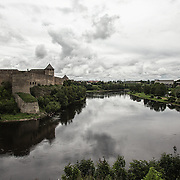 Narva river separates Estonia from Russia and the two parts of the Hermann Castle of Narva
