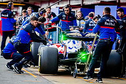 February 19, 2019 - Montmelo, Barcelona, Catalonia, Spain - Barcelona-Catalunya Circuit, Montmelo, Catalonia, Spain - 19/02/2018: Alex Albon of Scuderia Toro Rosso Honda with the new STR14 car is pushed by his teammates during second journey of F1 Test Days in Montmelo circuit. (Credit Image: © Javier Martinez De La Puente/SOPA Images via ZUMA Wire)