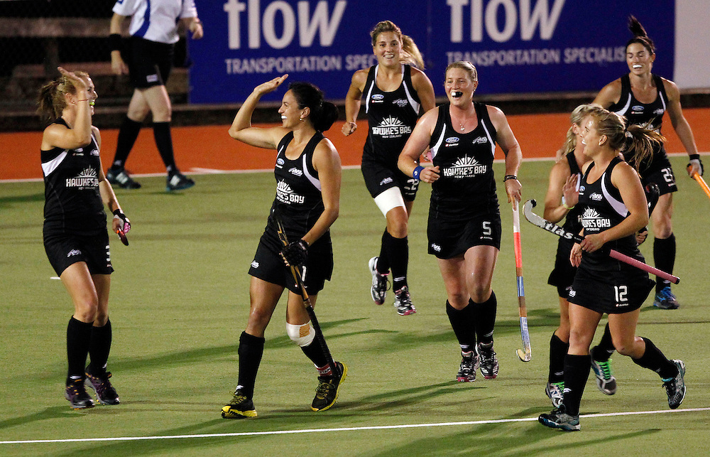 New Zealand's Kayla Sharland, centre, celebrates her goal against Australia during the four nations hockey final at North Harbour Hockey Stadium, Auckland, New Zealand, Monday, April 16, 2012. Credit:SNPA / Ben Campbell..