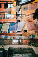 Prayer flags near an old well amidst the small alleyways of Patan, Nepal.