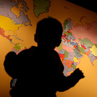 A young boy takes a look at the world map inside a coffee shop in Columbia, S.C.©Travis Bell Photography