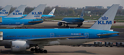 KLM airplanes are lined up at the terminal at Schiphol Airport in Amsterdam, the Netherlands, on Tuesday, April 20, 2010. (Photo © Jock Fistick)