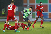 Terell Thomas of Wimbledon is fouled by Séamus Conneely of Accrington   during the EFL Sky Bet League 1 match between Accrington Stanley and AFC Wimbledon at the Fraser Eagle Stadium, Accrington, England on 1 February 2020.