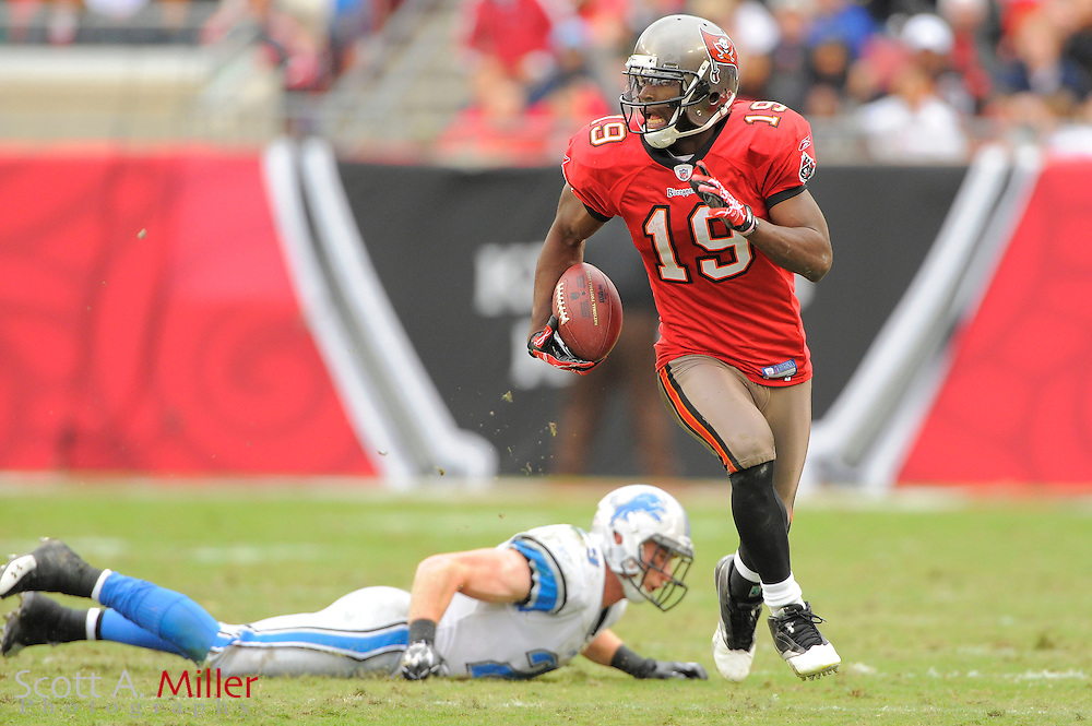 Dec. 19, 2010; Tampa, FL, USA; Tampa Bay Buccaneers wide receiver Mike Williams (19) runs upfield during the second half of the Detroit Lions 23-20 overtime win over the Bucs at Raymond James Stadium. ..©2010 Scott A. Miller