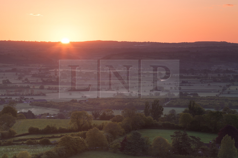 © Licensed to London News Pictures. 20/05/2015. Glastonbury, UK. Sunrise from Glastonbury Tor this morning, 20th May 2015. The day has started off clear, with early morning temperatures near freezing in places in the south west of England. Photo credit : Rob Arnold/LNP