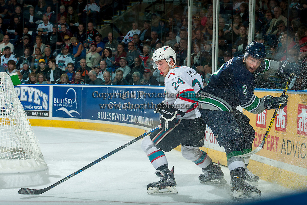 KELOWNA, CANADA - APRIL 22: Tyson Baillie #24 of Kelowna Rockets checks Jerret Smith #2 of Seattle Thunderbirds in the corner on April 22, 2016 at Prospera Place in Kelowna, British Columbia, Canada.  (Photo by Marissa Baecker/Shoot the Breeze)  *** Local Caption *** Tyson Baillie; Jerret Smith;