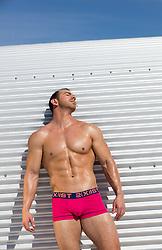 muscular man in tight briefs