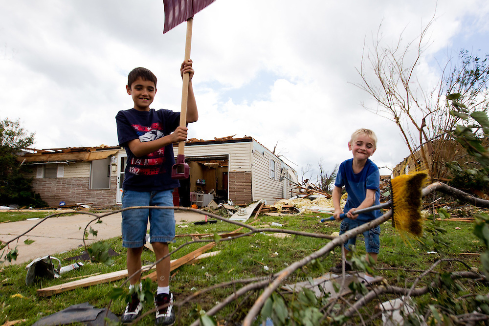 May 25, 2011- Dominic Blanchette and Kendal Jones of Joplin, Missouri try to help in the recovery effort at their grandfather's home after a tornado came through the town on Sunday, May 22, 2011. Credit: David Welker / TurfImages.com