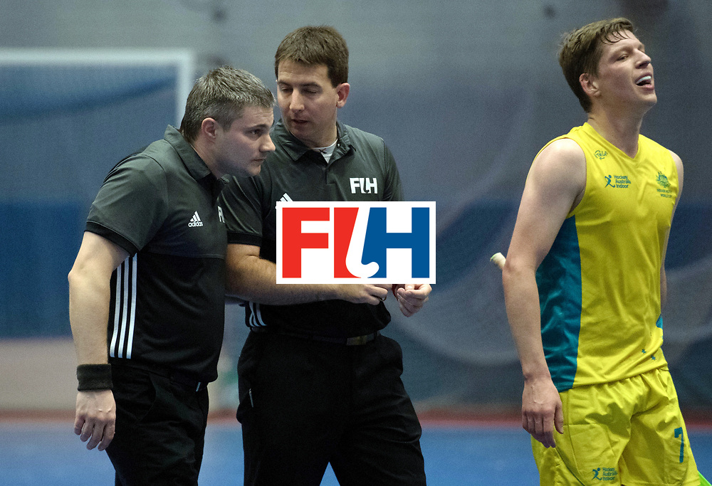 BERLIN - Indoor Hockey World Cup<br /> Trinidad &amp; Tobago - Australia<br /> foto: Umpires<br /> WORLDSPORTPICS COPYRIGHT FRANK UIJLENBROEK