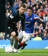 Celtic's Artur Boruc takes a chance as Rangers' Kyle Lafferty close him down during the League Cup final between Rangers and Celtic at Hampden Park -<br /> David Young Universal News And Sport