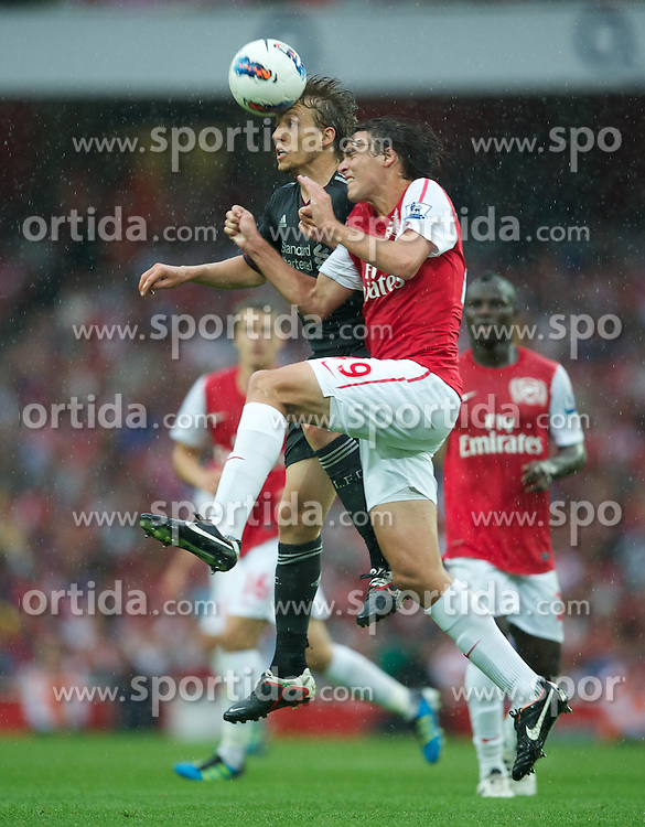 20.08.2011, Emirates Stadium, London, ENG, PL, FC Arsenal vs Liverpool FC, im Bild Liverpool's Lucas Leiva in action against Arsenal's Ignasi Miquel during the Premiership match at the Emirates Stadium, EXPA Pictures © 2011, PhotoCredit: EXPA/ Propaganda/ D. Rawcliffe *** ATTENTION *** UK OUT!