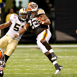 Oct 24, 2010; New Orleans, LA, USA; New Orleans Saints linebacker Jonathan Vilma (51) hits Cleveland Browns running back Mike Bell (22) on a run during the second half at the Louisiana Superdome. The Browns defeated the Saints 30-17.  Mandatory Credit: Derick E. Hingle