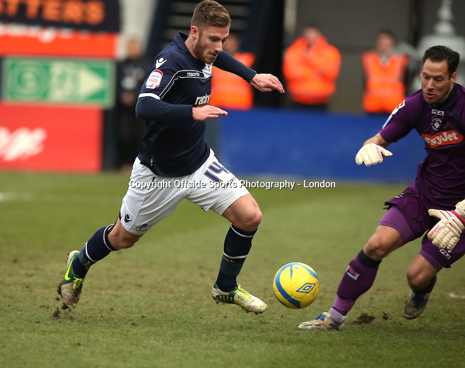 16 February 2013 FA Cup 5th round. Luton Town v Millwall.<br /> James Henry takes the ball round Luton goalkeeper Mark Tyler before scoring the first Millwall goal.<br /> Photo: Mark Leech