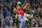 Manchester United Defender Luke Shaw battles with Brighton and Hove Albion forward Glenn Murray (17) in the air during the Premier League match between Brighton and Hove Albion and Manchester United at the American Express Community Stadium, Brighton and Hove, England on 4 May 2018. Picture by Phil Duncan.