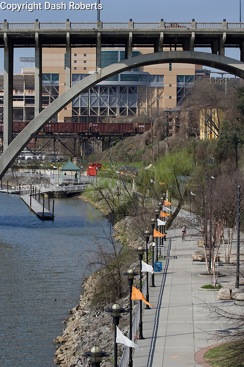The Neyland Greenway winds  along the Tennessee River in downtown Knoxville, Tn. with the University of Tennessee's Neyland Stadium in the background.