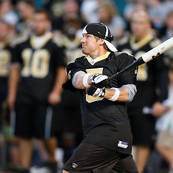 Apr 28, 2010; Metairie, LA, USA; Garrett Hartley (5) connects hits a homerun during the Heath Evans Foundation charity softball game featuring teammates of the Super Bowl XLIV Champion New Orleans Saints at Zephyrs Field.  Mandatory Credit: Derick E. Hingle-US-PRESSWIRE.