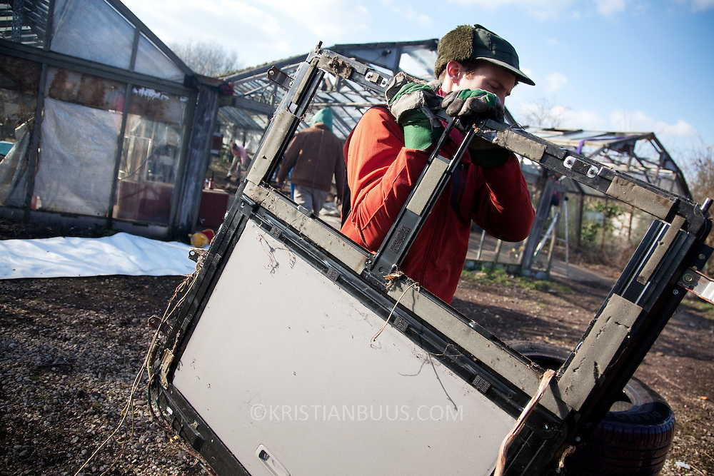 Activists and local residents in Sipson have squatted the former garden centre Berkeley Nurseries on the site of the proposed 3rd runway at Heathrow. On Saturday March 6 work starts with clearing the site of decades old rubbish to turn it back into a community run nursery producing fruit and vegetables. The project is called Transition Heathrow and all are welcome to participate.<br /> <br /> All images copyrighted to Kristian Buus.<br /> They can be used for non-commercial purpose for free, any commercial reproduction only in agreement with Kristian Buus.<br /> Contact: kbuus@kristianbuus.com<br /> 07768055848