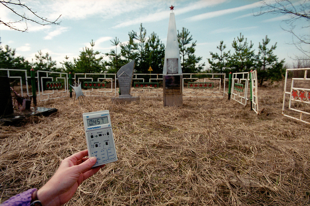 Chernobyl Legacy. ..Ukraine 2001...A radiation counter shows high levels of radiation on a gravesite near the burned out Chernobyl reactor. Here many soldiers and firemen who were called out to put out the fire and isolate the reactor after the disaster, who later passed away due to radiation sickness, are buried...Photo: Markus Marcetic/MOMENT..