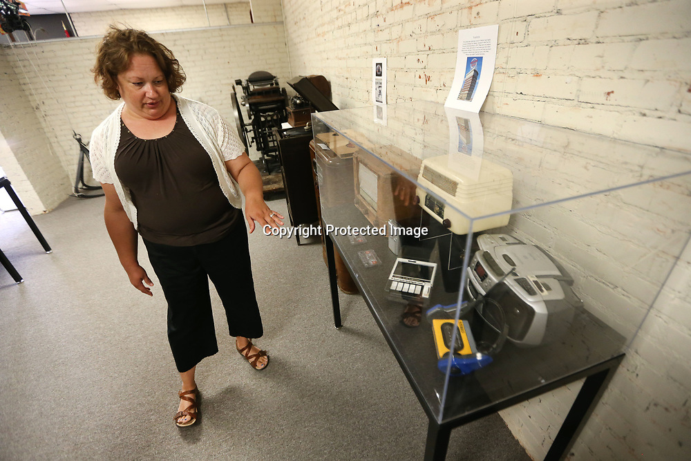 "Rae Mathis Guess, Curator at the Oren Dunn City Museum in Tupelo, points out items in the ""Bells & Whistles"" Vintage Technology Exhibit that is on display at the museum until July 21."