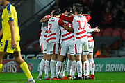 Doncaster Rovers players surround Tommy Rowe of Doncaster Rovers (10) after Rowe scores to make it 2-1 during the EFL Sky Bet League 1 match between Doncaster Rovers and AFC Wimbledon at the Keepmoat Stadium, Doncaster, England on 17 November 2018.